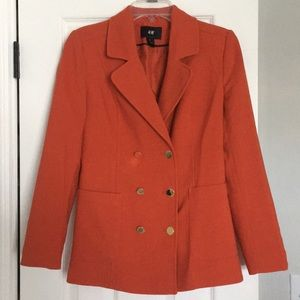 Orange H&M jacket with gold buttons